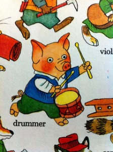 "Illustrated pig playing a drum from children's author Richard Scarry's book ""Busy Busy Town,"" 2000."
