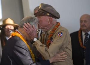 Jerry Yellin, a former captain and World War Two Army Air Force P-51 pilot, embraces Hiroya Sugano, director general of the Zero Fighter Admirers Club, during the 6th annual Blackened Canteen ceremony at the USS Arizona Memorial, during the 75th Commemoration of the attacks on Pearl Harbor, Hawaii, U.S. December 6, 2016. US Navy/Petty Officer 2nd Class Somers Steelman/Handout via REUTERS