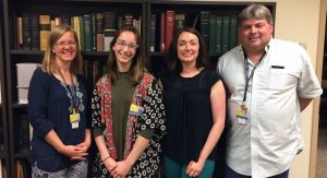 Photo: Hugh Hawkins Fellow Tiffany Brocke (second from left) with archivists Phoebe Evans Letocha, Jennifer Kinniff, and Andy Harrison at the Chesney Medical Archives.